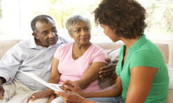 caregiver introducing benefits to old couople