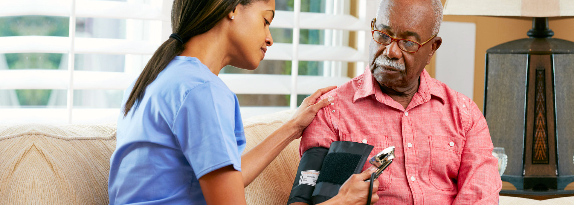 caregiver taking blood pressure