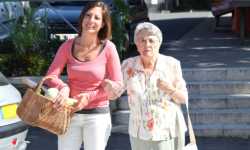 caregiver and old woman walking